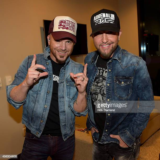 Chris Lucas and Preston Brust of the LoCash Cowboys pose backstage at the Paradigm Agency at the Paradigm Party during Day 2 of the IEBA 2014...