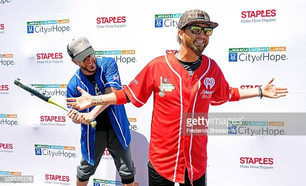 Chris Lucas and Preston Brust pose for a photo at the 26th Annual City of Hope Celebrity Softball Game at First Tennessee Park on June 7 2016 in...