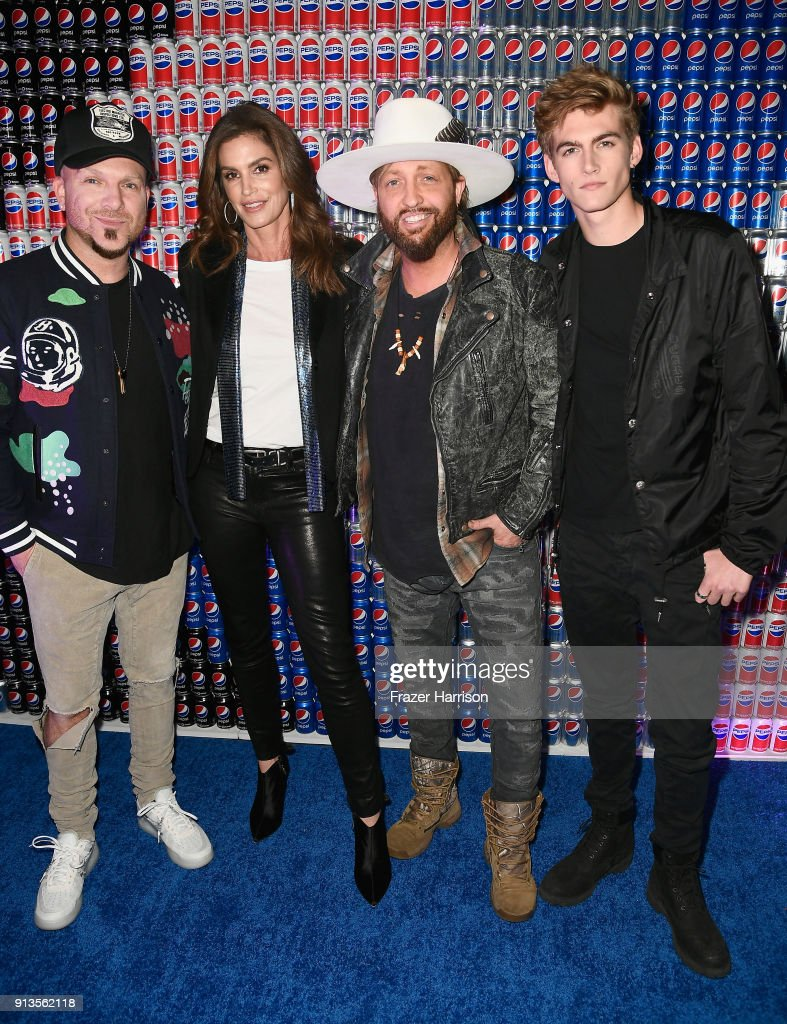 Chris Lucas of LOCASH, Cindy Crawford, Preston Brust of LOCASH, and Presley Gerber at Pepsi Generations Live Pop-Up on February 2, 2018 in Minneapolis, Minnesota.