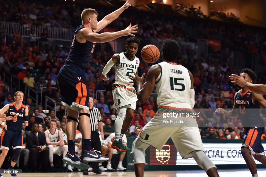 Chris Lykes #2 of the Miami Hurricanes passes the basketball to Ebuka Izundu during the second half of the game against the Virginia Cavaliers at The Watsco Center on February 13, 2018 in Miami, Florida.