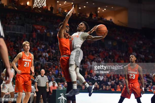 Chris Lykes of the Miami Hurricanes takes a shot while being defended by Paschal Chukwu of the Syracuse Orange during the second half of the game at...