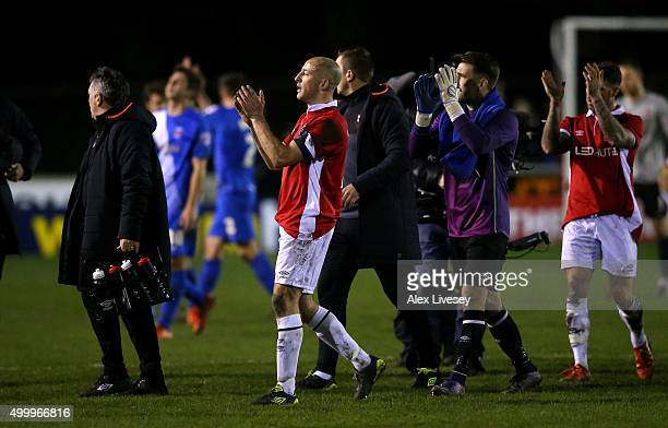 Chris Lynch of Salford City applauds the fans with his team mates following the Emirates FA Cup Second Round match between Salford City and...