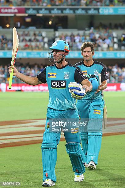 Chris Lynn and Joe Burns of the Heat celebrate winning the Big Bash League between the Brisbane Heat and Hobart Hurricanes at The Gabba on December...