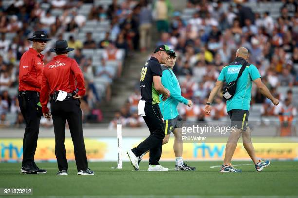 Chris Lynn of Australia leaves the field injured during the International Twenty20 Tri Series Final match between New Zealand and Australia at Eden...
