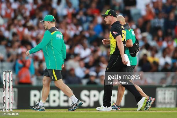 Chris Lynn of Australia walks off injured during the International Twenty20 Tri Series Final match between New Zealand and Australia at Eden Park on...