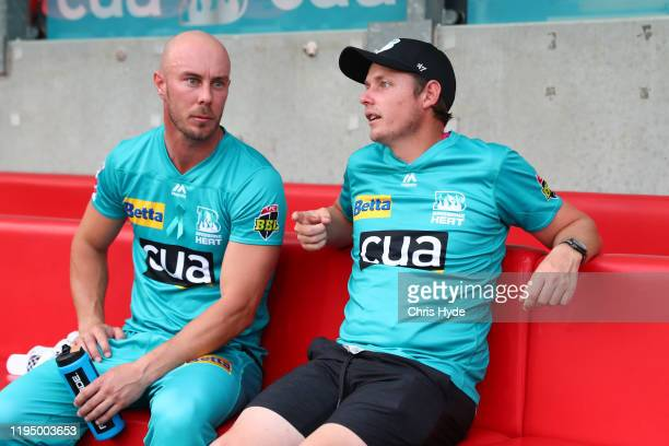 Chris Lynn of the Heat and Golfer Cameron Smith talk before the Big Bash League Match between the Brisbane Heat and the Melbourne Stars at Metricon...