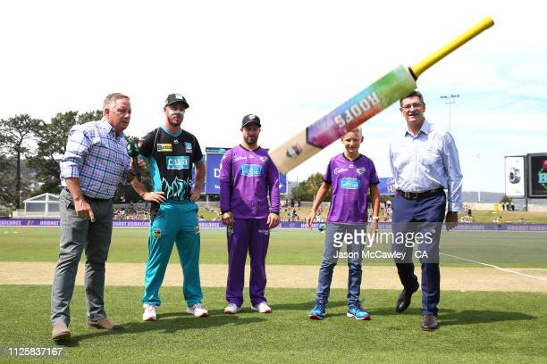 Chris Lynn of the Heat and Matthew Wade of the Hurricanes take part in the bat toss prior to the Big Bash League match between the Hobart Hurricanes...