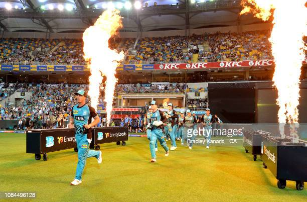 Chris Lynn of the Heat and team mates come out to the field of play during the Big Bash League match between the Brisbane Heat and the Adelaide...