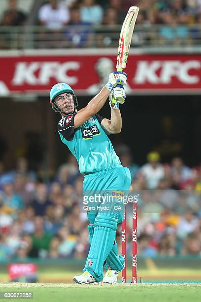 Chris Lynn of the Heat bats during the coin toss before the Big Bash League between the Brisbane Heat and Hobart Hurricanes at The Gabba on December...
