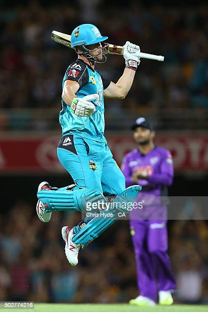 Chris Lynn of the Heat celebrates after reaching a century during the Big Bash League match between the Brisbane Heat and Hobart Hurricanes at The...