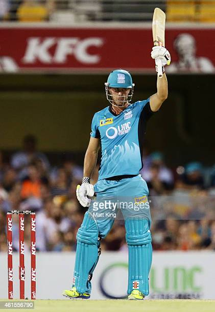 Chris Lynn of the Heat celebrates and acknowledges the crowd after scoring a half century during the Big Bash League match between the Brisbane Heat...