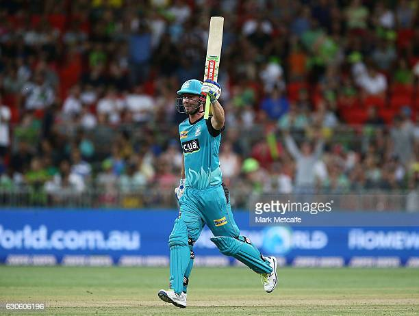 Chris Lynn of the Heat celebrates victory after winning the Big Bash League match between the Sydney Thunder and Brisbane Heat at Spotless Stadium on...