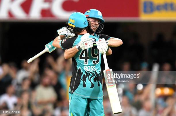 Chris Lynn of the Heat celebrates victory with team mate Alex Ross after the Big Bash League match between the Brisbane Heat and the Perth Scorchers...