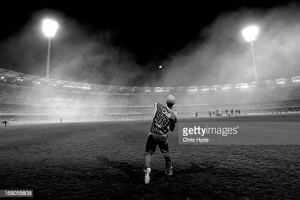 Chris Lynn of the Heat fields during the interval of the Big Bash League match between the Brisbane Heat and the Sydney Sixers at The Gabba on...