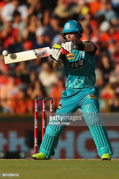 Chris Lynn of the Heat hits a boundary off David Willey of the Scorchers during the Big Bash League match between the Perth Scorchers and the...