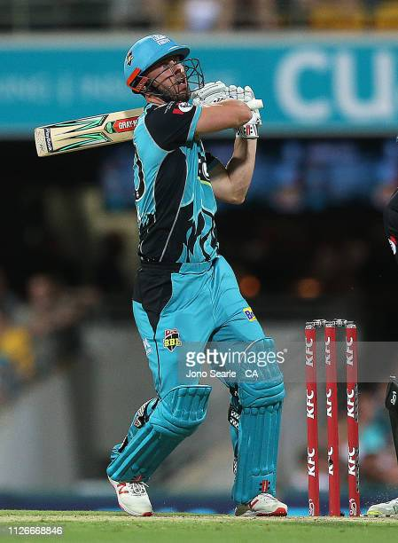 Chris Lynn of the Heat hits a six during the Big Bash League match between the Brisbane Heat and the Perth Scorchers at The Gabba on February 01 2019...