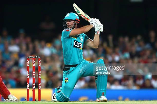 Chris Lynn of the Heat hits a six during the Big Bash League match between the Brisbane Heat and Melbourne Renegades at The Gabba on January 19, 2020...