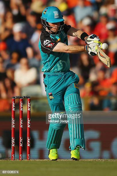 Chris Lynn of the Heat hits a six off his first ball faced from David Willey of the Scorchers during the Big Bash League match between the Perth...