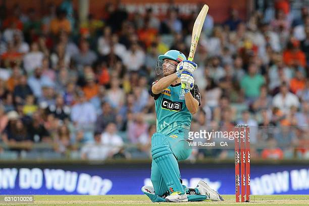 Chris Lynn of the Heat hits his eleventh six to win the game during the Big Bash League match between the Perth Scorchers and the Brisbane Heat at...