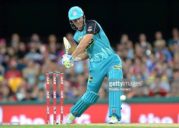 Chris Lynn of the Heat hits the ball over the boundary and on the roof of the stadium for a six during the Big Bash League between the Brisbane Heat...
