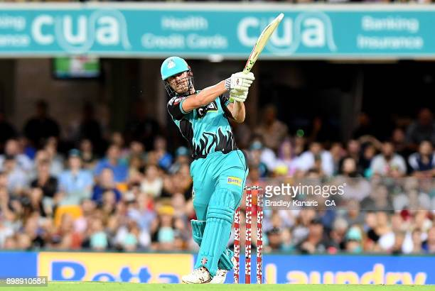 Chris Lynn of the Heat hits the ball over the boundary for a six during the Big Bash League match between the Brisbane Heat and the Sydney Thunder at...