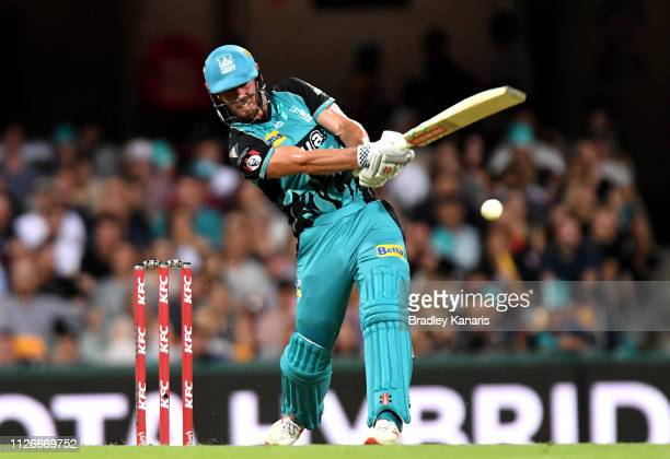 Chris Lynn of the Heat hits the ball to the boundary for a four during the Big Bash League match between the Brisbane Heat and the Perth Scorchers at...