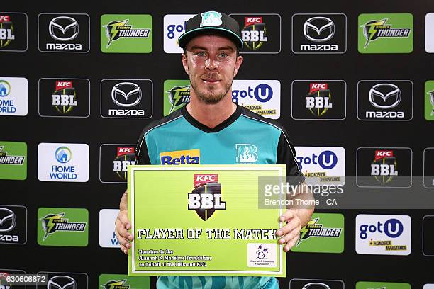 Chris Lynn of the Heat is awarded the'Player of the Match' award following the Big Bash League match between the Sydney Thunder and Brisbane Heat at...
