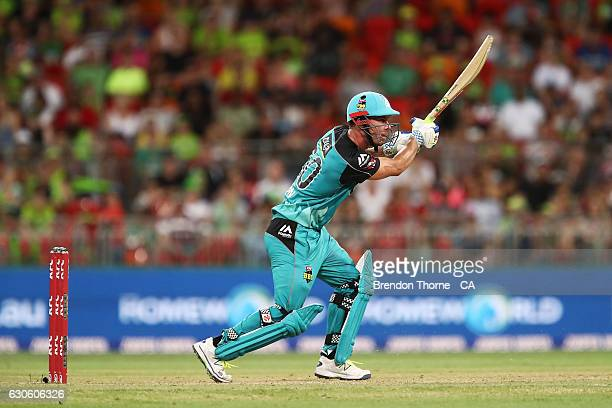 Chris Lynn of the Heat plays a cover drive during the Big Bash League match between the Sydney Thunder and Brisbane Heat at Spotless Stadium on...