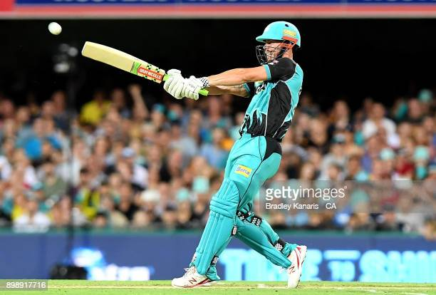 Chris Lynn of the Heat plays a shot during the Big Bash League match between the Brisbane Heat and the Sydney Thunder at The Gabba on December 27...
