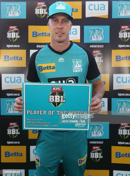 Chris Lynn of the Heat poses with the player of the match award during the Big Bash League match between the Brisbane Heat and the Sydney Sixers at...