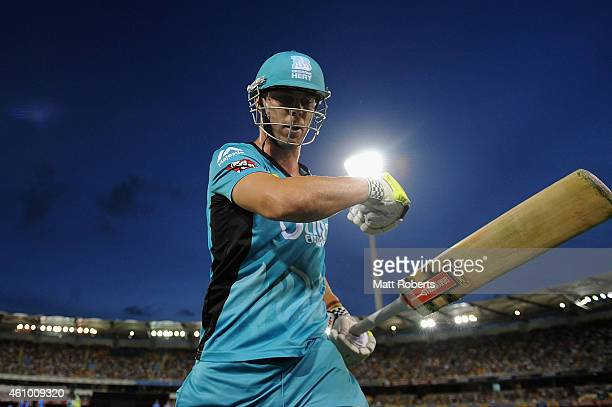 Chris Lynn of the Heat punches his bat after being dismissed during the Big Bash league match between the Brisbane Heat and the Adelaide Strikers at...
