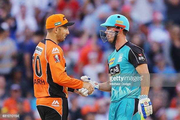 Chris Lynn of the Heat shakes the hand of Shaun Marsh of the Scorchers after hitting the winning runs during the Big Bash League match between the...