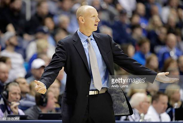 Chris Mack the head coach of the Xavier Musketeers gives instructions to his team against the Creighton Blue Jays during the game at Cintas Center on...