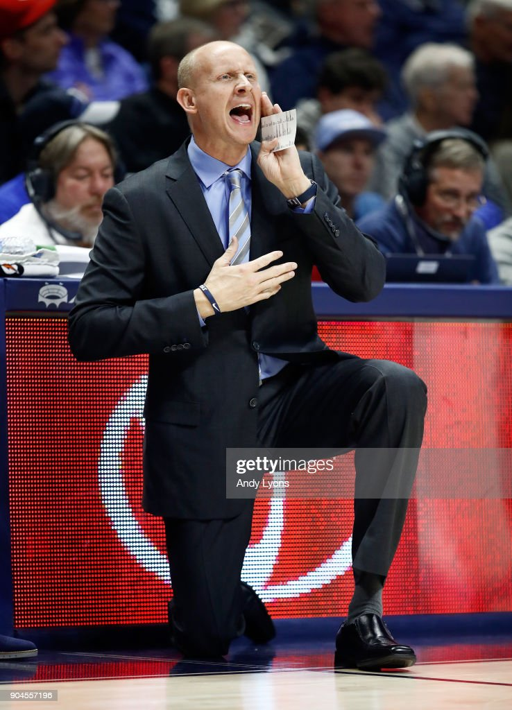 Chris Mack the head coach of the Xavier Musketeers gives instructions to his team against the Creighton Bluejays at Cintas Center on January 13, 2018 in Cincinnati, Ohio.