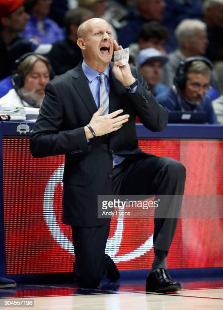Chris Mack the head coach of the Xavier Musketeers gives instructions to his team against the Creighton Bluejays at Cintas Center on January 13 2018...