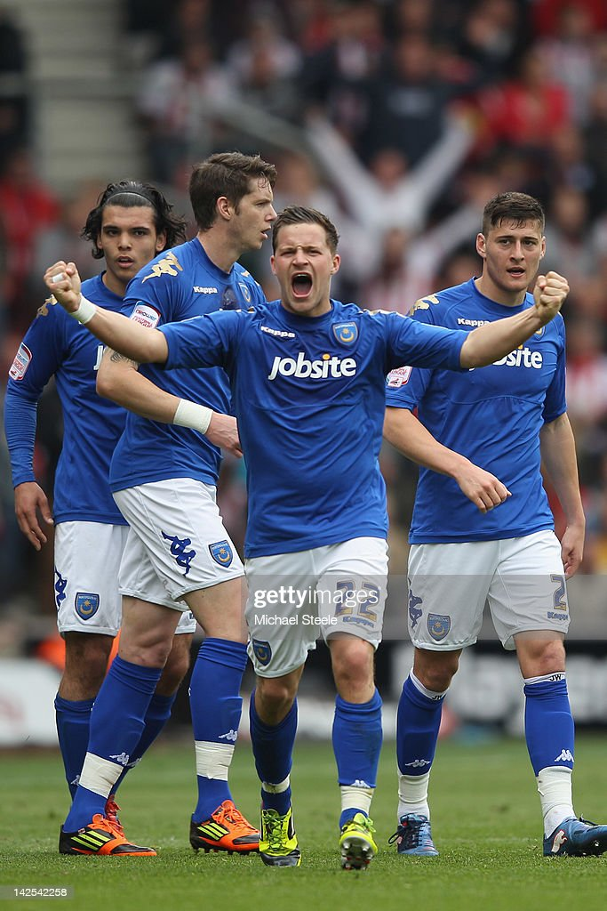 Chris Maguire (C) of Portsmouth celebrates scoring his sides equalising goal during the npower Championship match between Southampton and Portsmouth at St Mary's Stadium on April 7, 2012 in Southampton, England.