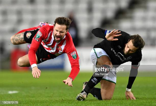 Chris Maguire of Sunderland is fouled by Jorge Grant of Lincoln City during the Papa John's Trophy Semi-Final match between Sunderland and Lincoln...