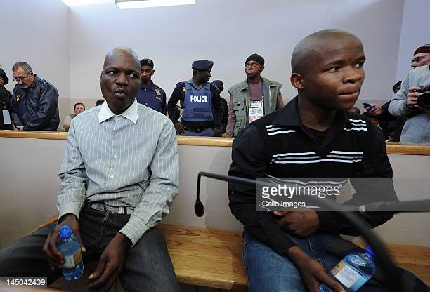 Chris Mahlangu and Patrick Ndlovu appear on trial at the Ventersdorp magistrates court on May 22 2012 in Ventersdorp South Africa The two are accused...
