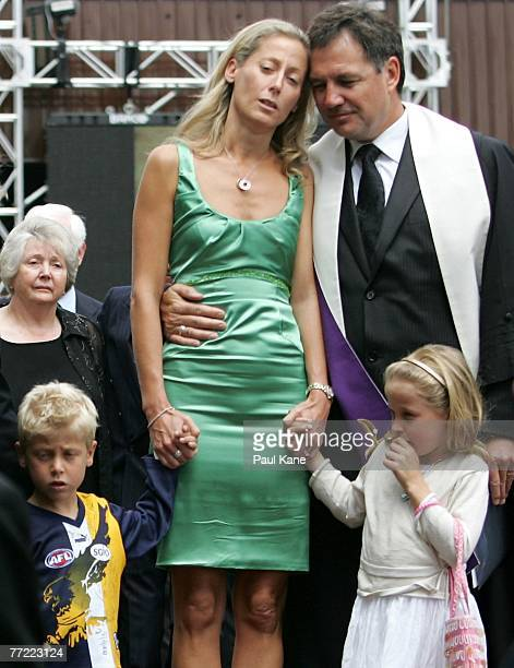 Chris Mainwaring's wife Rani Mainwaring is comforted by Neale Fong as she stands with son Zac Mainwaring and daughter Maddy Wainwaring as the casket...