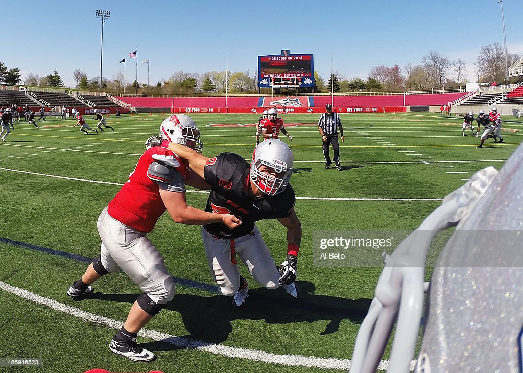 Chris Makulik #40 of the Stony Brook Defense rushes Quarterback Conor Bednarski during their Spring Football Game at Kenneth P. LaValle Stadium on April 26, 2014 in Stony Brook, New York.