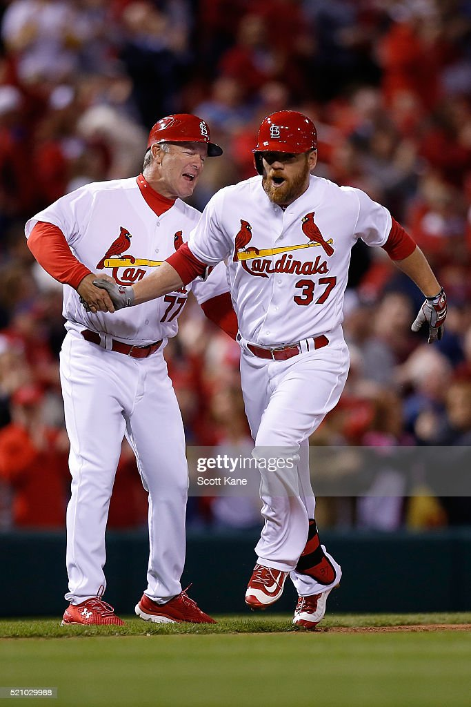 Chris Maloney #77 of the St. Louis Cardinals congratulates Brandon Moss #37 as he runs the bases after hitting a solo home run during the eighth inning of a baseball game against the Milwaukee Brewers at Busch Stadium on April 13, 2016 in St. Louis, Missouri.