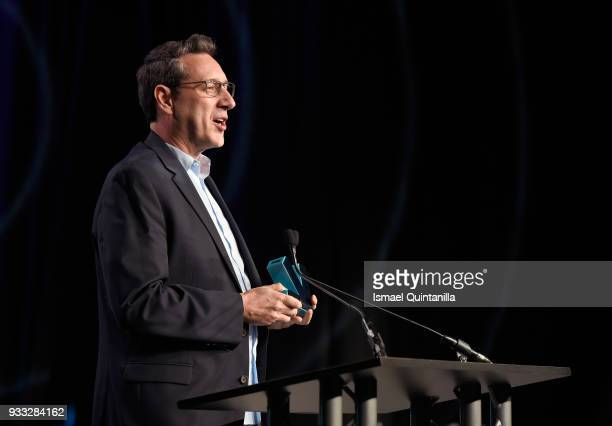 Chris Mancil accepts the Excellence in Convergence award onstage at SXSW Gaming Awards during SXSW at Hilton Austin Downtown on March 17 2018 in...