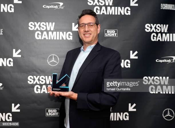 Chris Mancil poses with the Excellence in Convergence award at SXSW Gaming Awards during SXSW at Hilton Austin Downtown on March 17 2018 in Austin...