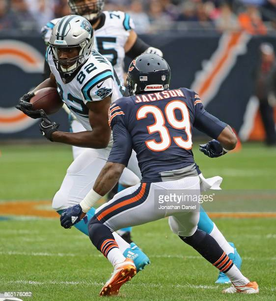 Chris Manhertz of the Carolina Panthers advances after a catch as Eddie Jackson of the Chicago Bears closes in at Soldier Field on October 22 2017 in...