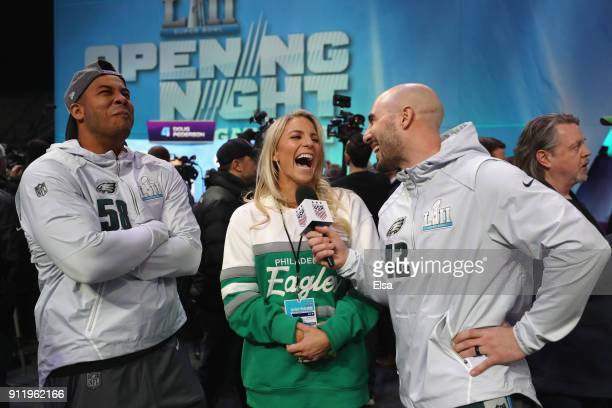 Chris Maragos of the Philadelphia Eagles talks with Jordan Hicks and Julie Ertz of the USA women's national soccer team and wife of Zach Ertz of the...
