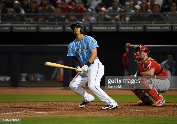 Chris Mariscal of the Seattle Mariners hits a two run home run during the fourth inning of a spring training game against the Cincinnati Reds at...