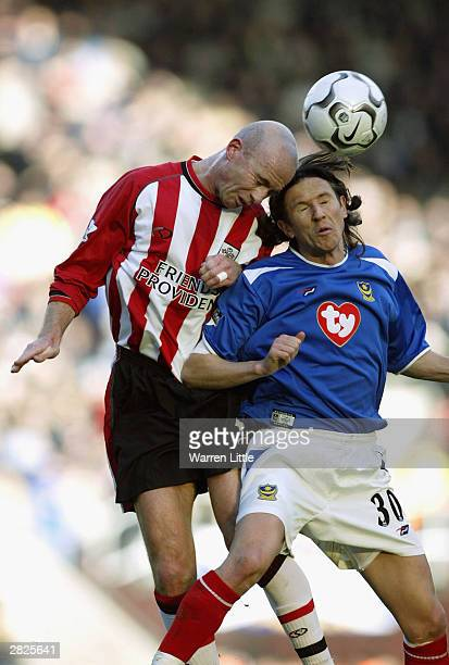 Chris Marsden of Southampton challenges Alexei Smertin of Portsmouth for the ball during the FA Barclaycard Premiership match between Southampton and...