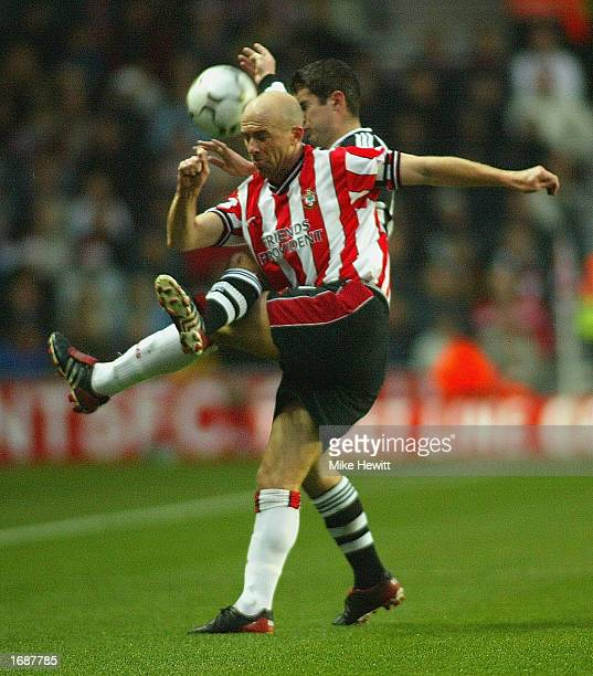 Chris Marsden of Southampton is challenged by Andrew Griffin of Newcastle during the FA Barclaycard Premiership match between Southampton and...