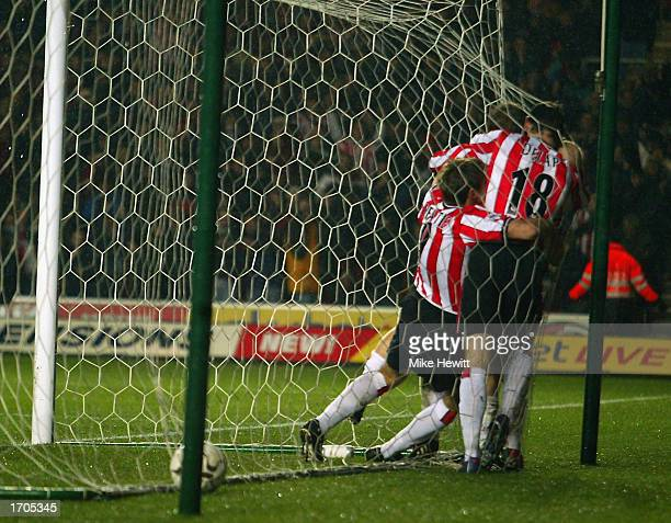 Chris Marsden of Southampton is congratulated by his team mates after scoring during the FA Barclaycard Premiership match between Southampton and...