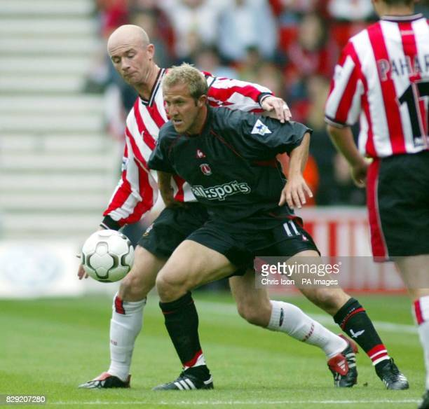 Chris Marsden of Southampton is held off by Charlton's John Robinson during their FA Barclaycard Premiership match at Southampton's St Mary's Stadium...